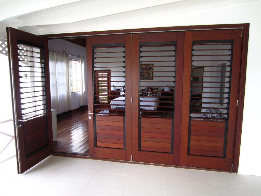 Breezway louvers with wood blades can be used for privacy and ventilation & Luxury Residential Home Kingston Jamaica