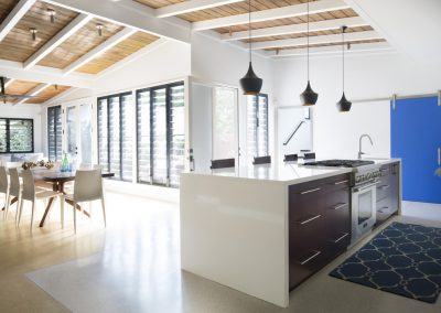 Open_plan_kitchen_and_dining_area_with_multiple_banks_of_breezway_louvres